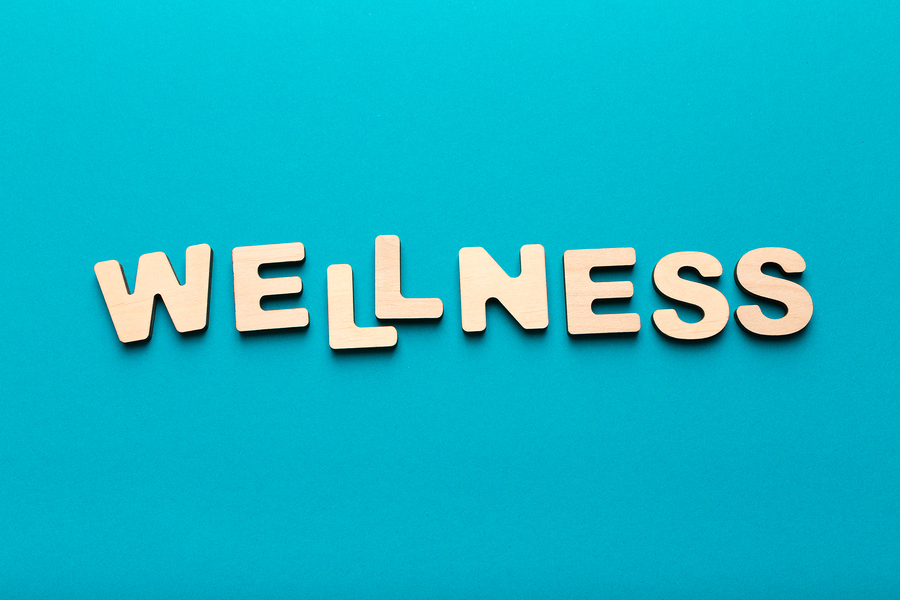 Wooden Letters Spelling Word Wellness, Top View, Copy Space. Healthcare Concept